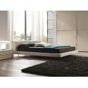 moderní postel s čalouněným čelem